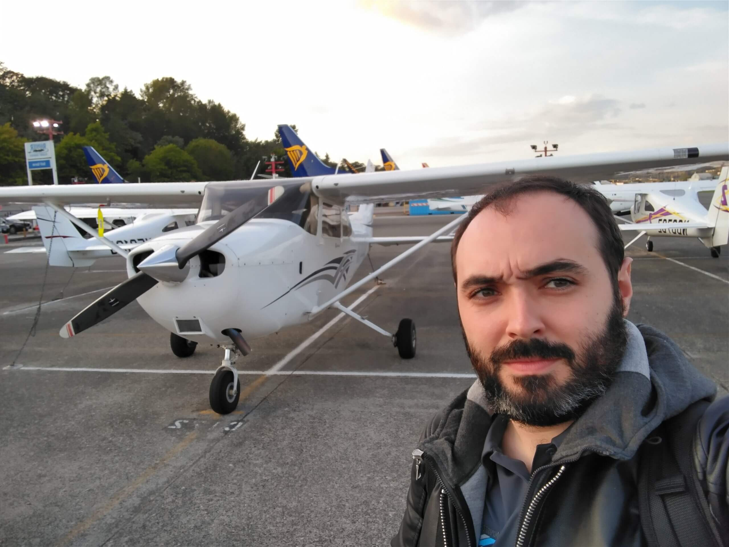 Lionel standing in front of a small plane