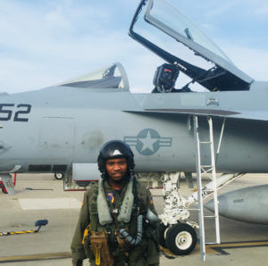 First Officer Courtland Savage in front of an F/A-18, Founder of Fly for the Culture (NPO)